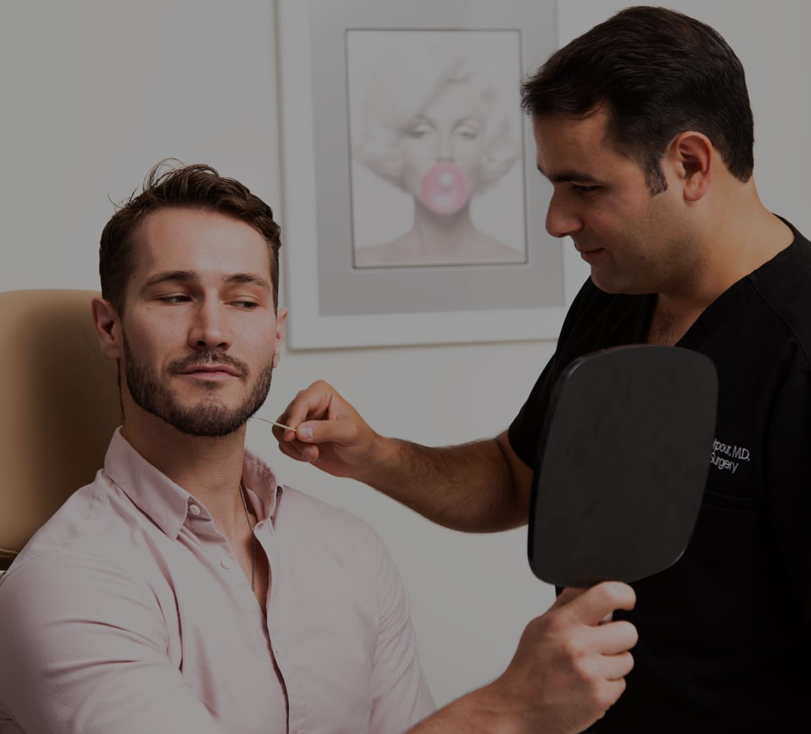 Dr. Ardesh with a facial plastic surgery patient in Los Angeles