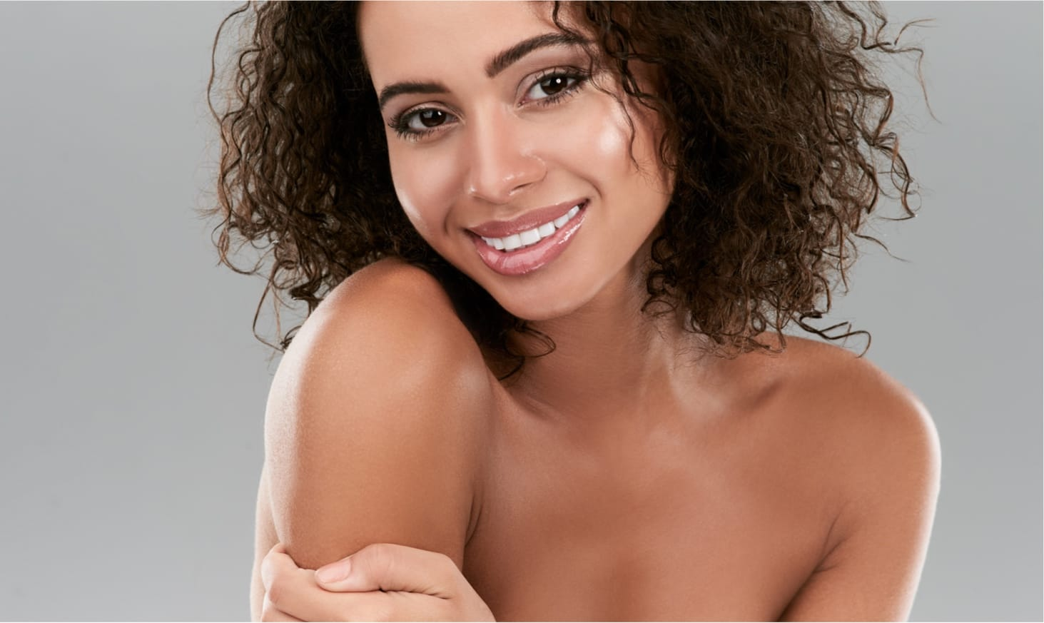 Smiling model with curly hair